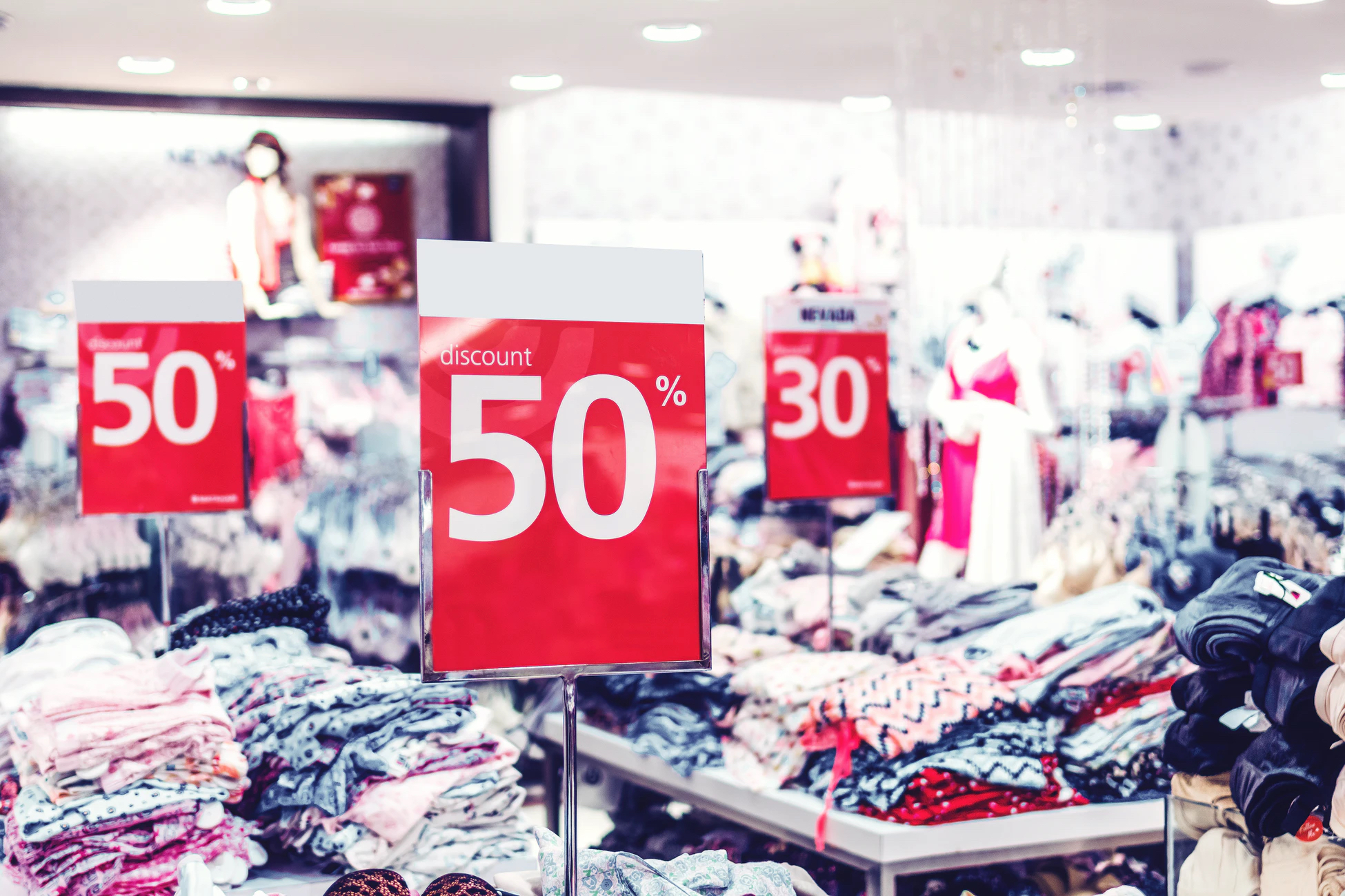 A store display with various items for sale at a discount with couponing.